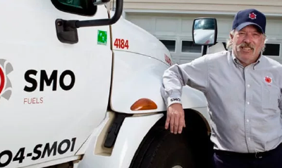 Man standing next to smo energy truck